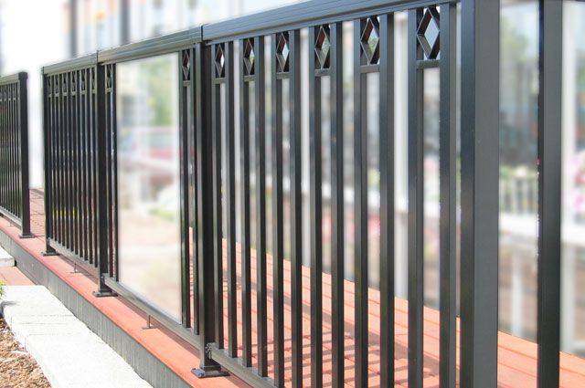 Black-Large-Glass-Panel-with-Pickets-and-Decorative-Spacer-Railing-on-low-platform